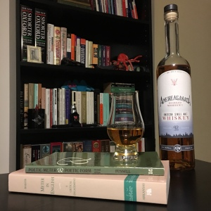 Books on poetic form rest on a table next to a filled Glencairn glass and a bottle of whisky, all in front of a bookcase holding academic tomes.