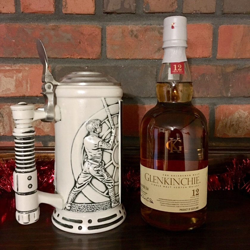 A Star Wars stein sits on a mantle beside a bottle of 12-year-old Glenkinchie whisky.